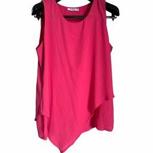 Fuchsia pink sleeveless blouse layered